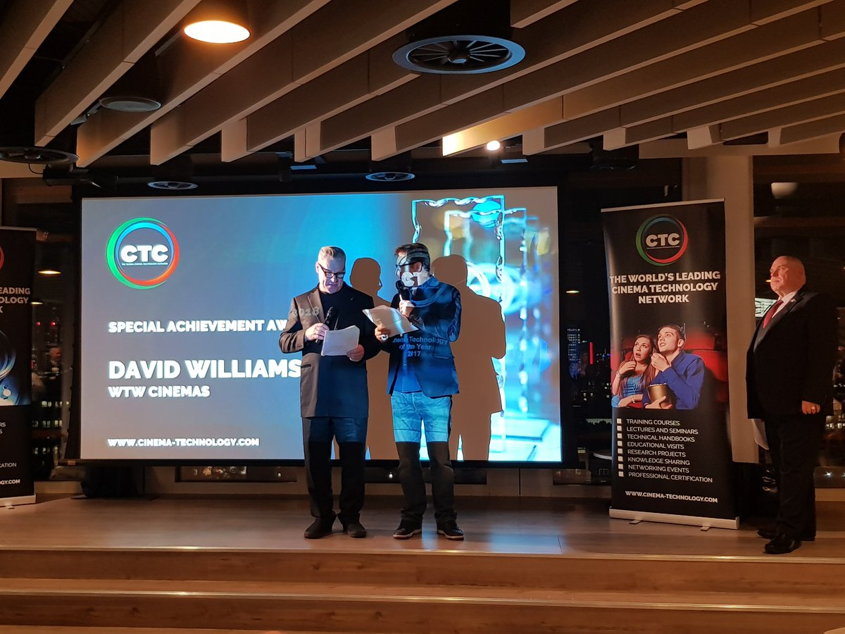 David Williams is represented by Robert Williams and receives an outstanding achievement award at the London offices of Universal Studios in a ceremony by The Cinema Technology Community.